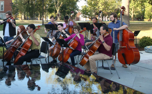 Music students performing with Yo-Yo Ma outside Stewart Plaza